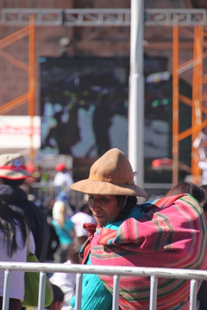 A Quechua woman in front of the big screen anniversary celebrations